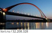 Купить «Ночное видео Бугринский мост в Новосибирске / Night video of cable-stayed bridge Bugrinskiy over river Ob in Novosibirsk, Siberia, Russia», видеоролик № 32208328, снято 31 августа 2019 г. (c) Serg Zastavkin / Фотобанк Лори
