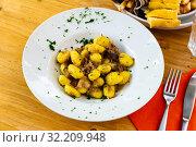 Купить «Gnocchi with mince and eggplant», фото № 32209948, снято 27 мая 2020 г. (c) Яков Филимонов / Фотобанк Лори