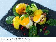 Купить «Fried eggs served with potatoes, bacon and cucumbers», фото № 32211108, снято 22 октября 2019 г. (c) Яков Филимонов / Фотобанк Лори