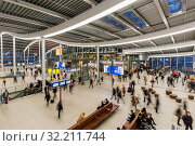 Купить «Utrecht, The Netherlands - October 12, 2016: Central hall of NS Central Railway Station Utrecht with walking and waiting people, The Netherlands.», фото № 32211744, снято 12 октября 2016 г. (c) age Fotostock / Фотобанк Лори