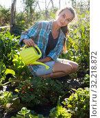 Купить «Woman watering plants in garden», фото № 32218872, снято 21 августа 2019 г. (c) Яков Филимонов / Фотобанк Лори