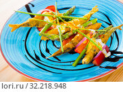Купить «Battered sprats with creamy ginger sauce, tomatoes, balsamic», фото № 32218948, снято 23 августа 2018 г. (c) Яков Филимонов / Фотобанк Лори