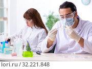 Купить «Two chemists working in the lab», фото № 32221848, снято 13 мая 2019 г. (c) Elnur / Фотобанк Лори