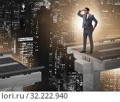 Купить «Businessman ready to overcome the broken bridge», фото № 32222940, снято 11 декабря 2019 г. (c) Elnur / Фотобанк Лори