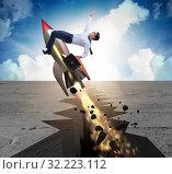 Купить «Businessman flying on rocket from rock gap», фото № 32223112, снято 5 июня 2020 г. (c) Elnur / Фотобанк Лори