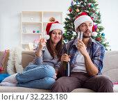 Купить «Happy couple celebrating christmas holiday», фото № 32223180, снято 21 июля 2017 г. (c) Elnur / Фотобанк Лори