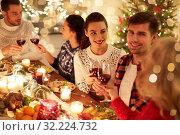 Купить «happy friends celebrating christmas at home feast», фото № 32224732, снято 17 декабря 2017 г. (c) Syda Productions / Фотобанк Лори