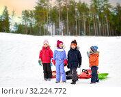 Купить «happy little kids with sleds in winter», фото № 32224772, снято 10 февраля 2018 г. (c) Syda Productions / Фотобанк Лори