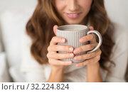 Купить «close up of happy woman with cup of coffee at home», фото № 32224824, снято 15 октября 2016 г. (c) Syda Productions / Фотобанк Лори