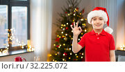 Купить «smiling boy in santa helper hat showing ok gesture», фото № 32225072, снято 9 марта 2019 г. (c) Syda Productions / Фотобанк Лори