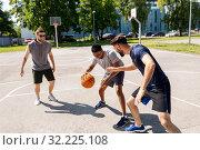 Купить «group of male friends playing street basketball», фото № 32225108, снято 21 июля 2019 г. (c) Syda Productions / Фотобанк Лори
