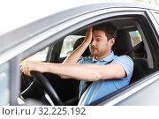 Купить «tired sleepy man or driver driving car», фото № 32225192, снято 25 августа 2019 г. (c) Syda Productions / Фотобанк Лори