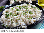 Купить «close-up of tasty Cauliflower rice or couscous», фото № 32228268, снято 8 мая 2019 г. (c) Oksana Zh / Фотобанк Лори