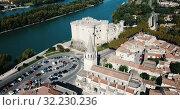 Купить «Aerial view of medieval fortified Chateau de Tarascon and Rhone river at sunny day», видеоролик № 32230236, снято 24 октября 2018 г. (c) Яков Филимонов / Фотобанк Лори