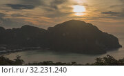 Купить «Time lapse of day clouds over the wonderful bay of Phi Phi island landscape with boats. Andaman sea lagoon.», видеоролик № 32231240, снято 24 апреля 2019 г. (c) Александр Маркин / Фотобанк Лори