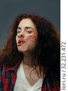 Woman's face crushed on glass, smeared lipstick. Стоковое фото, фотограф Tryapitsyn Sergiy / Фотобанк Лори