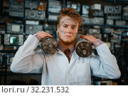 Купить «Scientist holds radiation devices in his hands», фото № 32231532, снято 17 июня 2019 г. (c) Tryapitsyn Sergiy / Фотобанк Лори