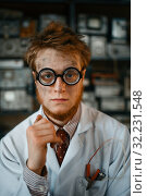 Купить «Portrait of strange male scientist in glasses», фото № 32231548, снято 17 июня 2019 г. (c) Tryapitsyn Sergiy / Фотобанк Лори