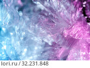 Holographic background in the style of the 80-90s. Real texture of cellophane film in bright acid colors. Стоковое фото, фотограф bashta / Фотобанк Лори
