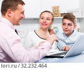 Купить «Mother and son signing documents», фото № 32232464, снято 28 марта 2017 г. (c) Яков Филимонов / Фотобанк Лори