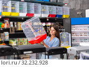 Купить «woman customer is looking a cage for canary bird», фото № 32232928, снято 17 ноября 2019 г. (c) Яков Филимонов / Фотобанк Лори