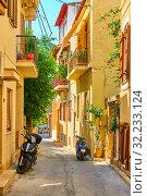 Купить «Colorful cosy street in Aegina town», фото № 32233124, снято 15 сентября 2019 г. (c) Роман Сигаев / Фотобанк Лори