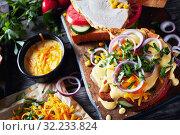 Купить «sandwiches with juicy slices of organic ham», фото № 32233824, снято 30 мая 2019 г. (c) Oksana Zh / Фотобанк Лори