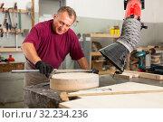 Купить «Worker performs measurements on wooden workpiece with caliper. Working with the measuring tool», фото № 32234236, снято 20 октября 2019 г. (c) Яков Филимонов / Фотобанк Лори