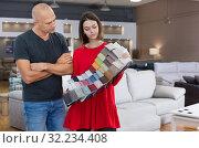 Купить «Consultant helping man choosing upholstery fabric», фото № 32234408, снято 29 октября 2018 г. (c) Яков Филимонов / Фотобанк Лори