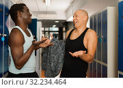 Купить «Two athletes in the locker room after training», фото № 32234464, снято 28 января 2019 г. (c) Яков Филимонов / Фотобанк Лори
