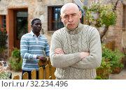 Купить «Conflict between neighbors in the country cottage», фото № 32234496, снято 15 декабря 2018 г. (c) Яков Филимонов / Фотобанк Лори