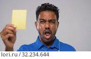 Купить «indian referee whistling and showing yellow card», видеоролик № 32234644, снято 12 сентября 2019 г. (c) Syda Productions / Фотобанк Лори