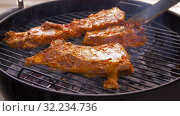 Купить «barbecue meat roasting on brazier grill outdoors», видеоролик № 32234736, снято 20 сентября 2019 г. (c) Syda Productions / Фотобанк Лори