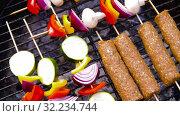 Купить «barbecue kebab meat and vegetables on grill», видеоролик № 32234744, снято 20 сентября 2019 г. (c) Syda Productions / Фотобанк Лори