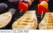 Купить «vegetables and mushrooms roasting on brazier grill», видеоролик № 32234760, снято 20 сентября 2019 г. (c) Syda Productions / Фотобанк Лори
