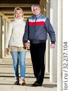 Купить «Married couple goes for walk between concrete pillars», фото № 32237104, снято 15 октября 2019 г. (c) Яков Филимонов / Фотобанк Лори