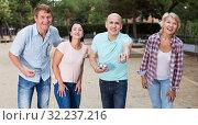 Купить «friendly mature couples playing petanque at leisure», фото № 32237216, снято 25 июля 2017 г. (c) Яков Филимонов / Фотобанк Лори