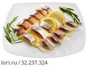 Купить «Fillet herring with rosemary, onion and lemon», фото № 32237324, снято 24 января 2020 г. (c) Яков Филимонов / Фотобанк Лори