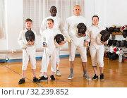 Купить «Portrait of happy mixed age group of athletes», фото № 32239852, снято 30 мая 2018 г. (c) Яков Филимонов / Фотобанк Лори