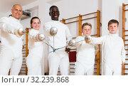 Купить «Portrait of ordinary mixed age group of athletes», фото № 32239868, снято 30 мая 2018 г. (c) Яков Филимонов / Фотобанк Лори