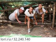 Купить «Emotional competition to overcome obstacle course in an amusement park», фото № 32240140, снято 3 июня 2020 г. (c) Яков Филимонов / Фотобанк Лори