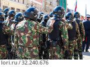 Купить «Counter terrorist squad fighters during an opposition protest rally», фото № 32240676, снято 5 мая 2018 г. (c) FotograFF / Фотобанк Лори