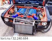 Купить «Tuned turbo car engine BMW in Lada vehicle», фото № 32240684, снято 19 мая 2018 г. (c) FotograFF / Фотобанк Лори