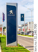 Купить «Official dealership sign of Peugeot company», фото № 32240700, снято 19 мая 2018 г. (c) FotograFF / Фотобанк Лори