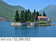 Купить «Perast, Montenegro - June 10. 2019 Natural islet with Saint George Benedictine monastery. Kotor Bay.», фото № 32240932, снято 10 июня 2019 г. (c) Володина Ольга / Фотобанк Лори