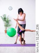 Купить «Girl and mother exercising at home», фото № 32241236, снято 16 июля 2019 г. (c) Elnur / Фотобанк Лори