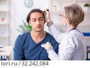 Купить «Young patient visiting doctor in hospital», фото № 32242084, снято 8 апреля 2019 г. (c) Elnur / Фотобанк Лори