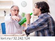 Купить «Young male alcoholic visiting old doctor», фото № 32242124, снято 3 апреля 2019 г. (c) Elnur / Фотобанк Лори
