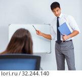Купить «Business presentation in the office with man and woman», фото № 32244140, снято 7 августа 2017 г. (c) Elnur / Фотобанк Лори