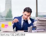 Купить «Workaholic businessman overworked with too much work in office», фото № 32245064, снято 11 октября 2016 г. (c) Elnur / Фотобанк Лори